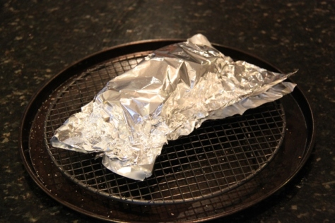 Cover the cooked meat with aluminium foil to rest