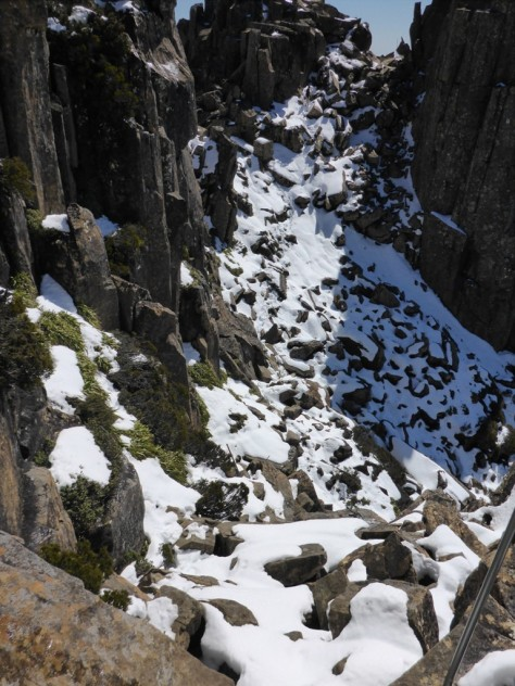 Reaching the summit of Cradle Mountain required walking through a bit of snow